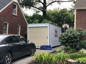 a portable storage unit in a driveway